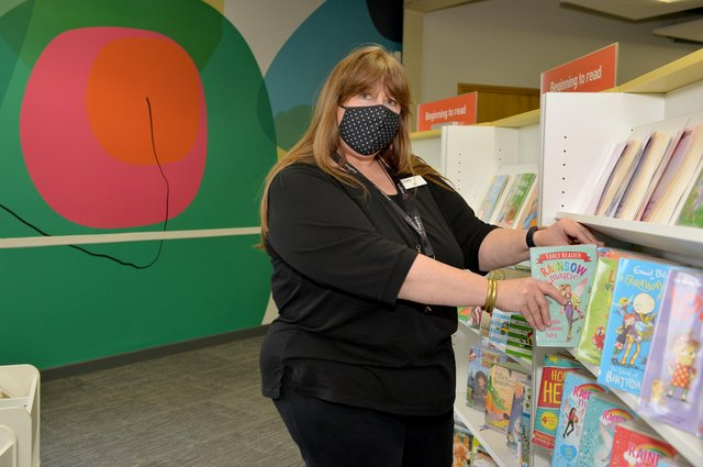 ally Kirk busy restocking the shelves ready for the reopening of Worksop Library.