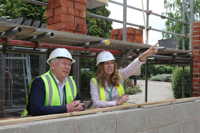 Bassetlaw District Council chief executive Neil Taylor and project manager Jane Harrison at the new block being built at the Canch - just one of three multi-million pound building projects being built in the town.