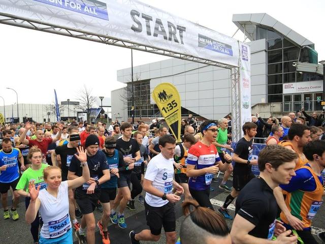Half marathon runners on Arundel Gate in Sheffield. Picture: Chris Etchells.