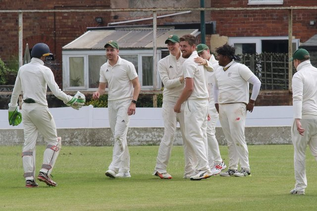 Woskop captain Harry Taylor is congratulated after taking a spectacular catch.