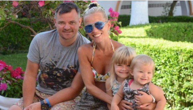 Helen Davy with her husband John, who passed away four years ago, with their children Annalise, eight and Kairen, five