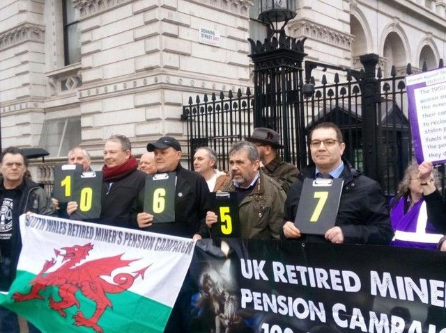 Former mineworkers outside Downing Street in 2019 after handing in a 100,000-strong petition calling for a fairer pension deal