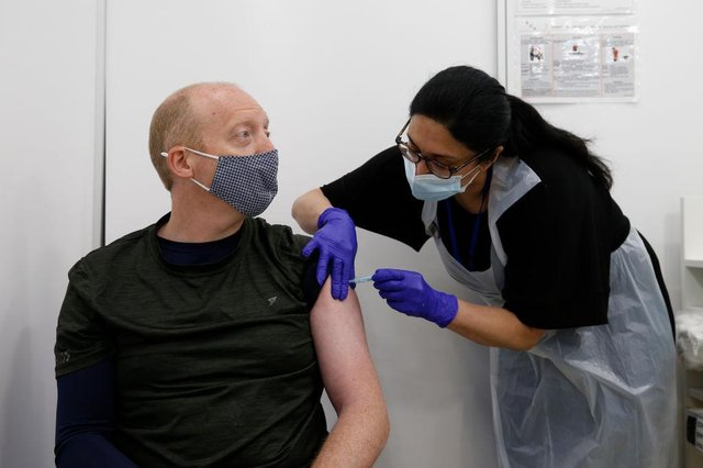 Martin Gillibrand, 45, receives an AstraZeneca vaccination. (Photo by Hollie Adams/Getty Images)