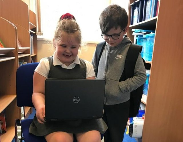 Pupils ay Langold Dyscarr Community School with one of the new laptops.