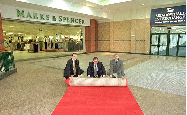 Marks & Spencer Meadowhall rolled out the red carpet for customers at the Meadowhall Centre for the opening of the new link between the Interchange bridge at the front of the store in 1999. Left to right, Darren Pearce, Finance Manager at Meadowhall Centre, Peter Walker, South Yorkshire Passenger Executive and Stefan Andrejczuk, M & S Meadowhall Store Manager.