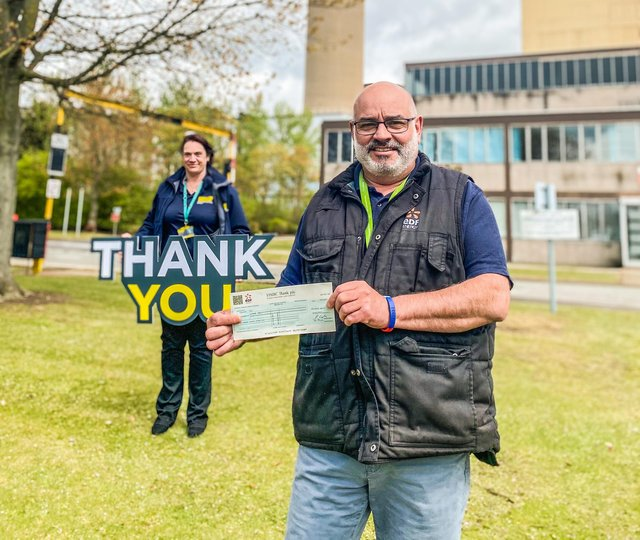 LIVES emergency responders collect the £1,000 donation.