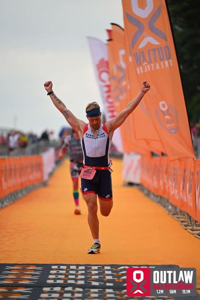 Adrian Hopkinson finishes the Outlaw Half Triathlon