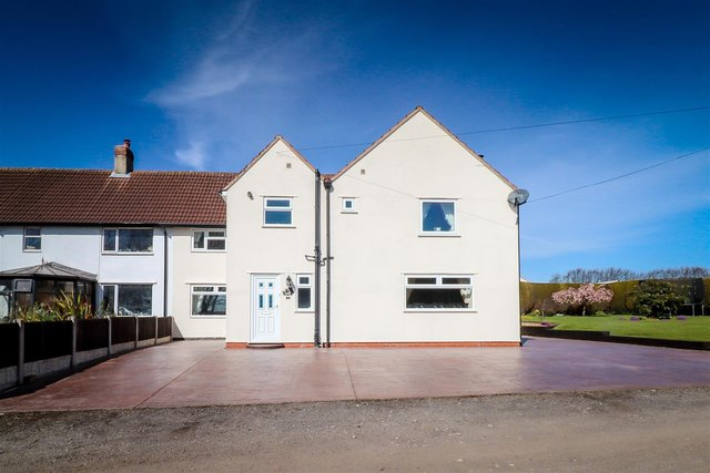 The property is a substantial six/seven-bedroom home.