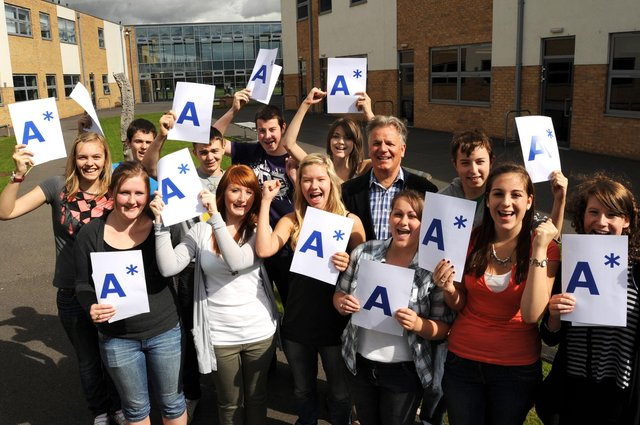 Headteacher Paul Buck pictured with pupils on results day for the last time before his retirement.