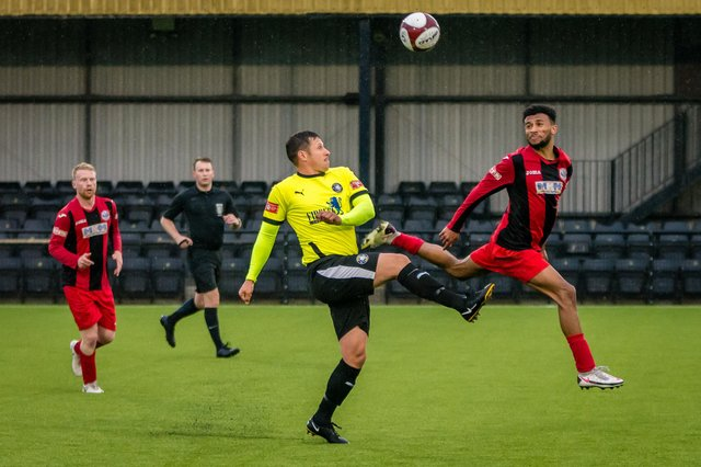 Ben Tomlinson battles for possession. Pic by Mike Holmes