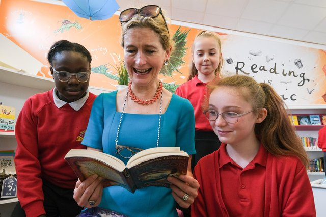 Children's Laureate Cressida Cowell MBE reading with pupils at Dinnigton Community Primary Schools new library