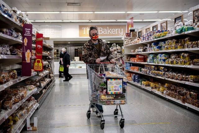 A man wearing a Union Jack flag design face mask shops in a Sainsburys supermarket. (Photo by Chris J Ratcliffe/Getty Images)