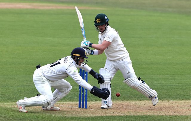 Tom Moores pulls the ball as Warwickshire wicket keeper Michael Burgess attempts a catch. (Photo by David Rogers/Getty Images)