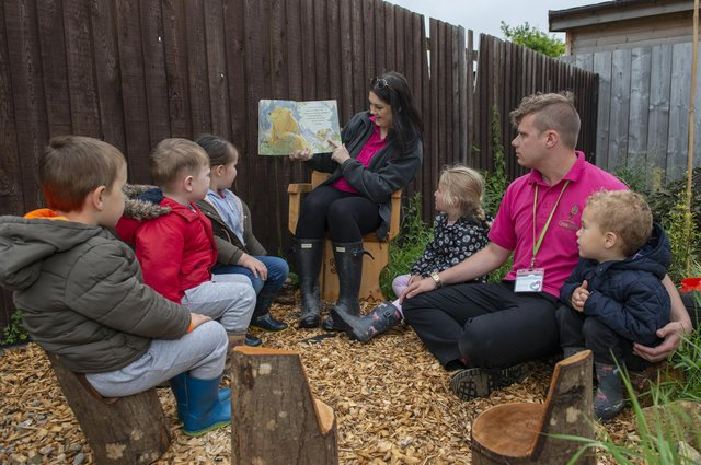 Lime Tree Nursery have created a new forest garden for the children, pictured with some of the children are Forest School leader Lizzi Hall and After School Room Lead Charlie Wright