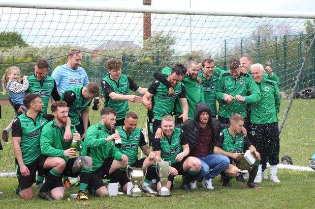 Greendale Oak celebrate with their trophy.