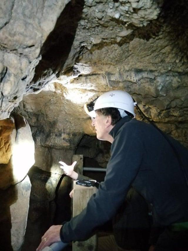 Sir Antony Gormley exploring Robin Hood Cave.