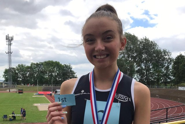 Olivia is all smiles after winning the 800m title.