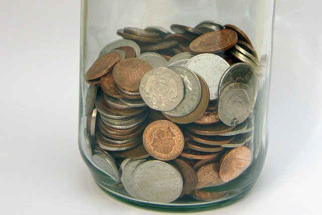 Stock photo glass Money bottle. Saving pennies