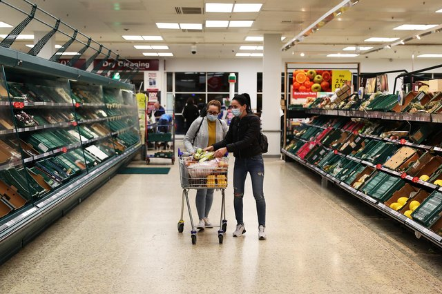 Shoppers are seen inside a Tesco store wearing face masks (Photo by Naomi Baker/Getty Images)
