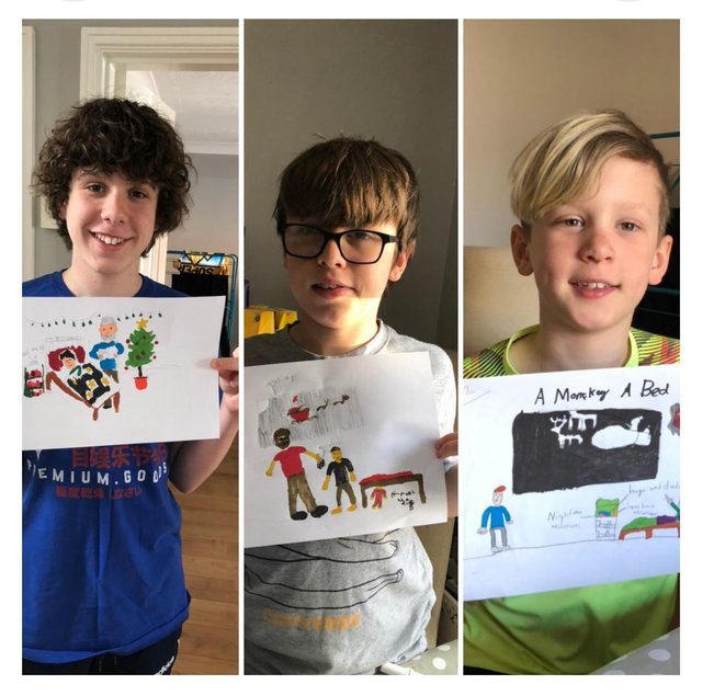 Harry, George, and Charlie with their initial book cover designs.