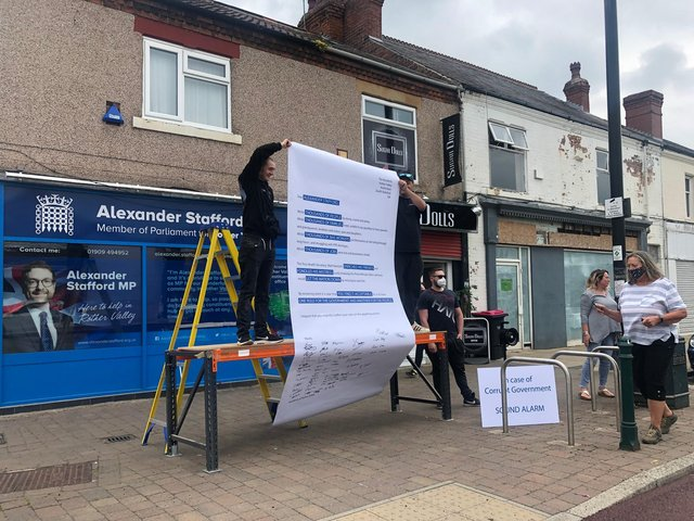 Protesters outside Rother Valley MP Alexander Stafford's constituency office, in Dinnington.