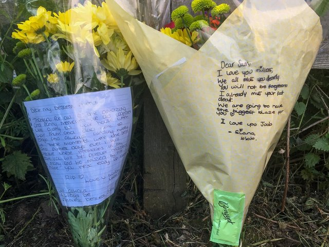 Floral tributes left after a male drowned at Ulley Country Park