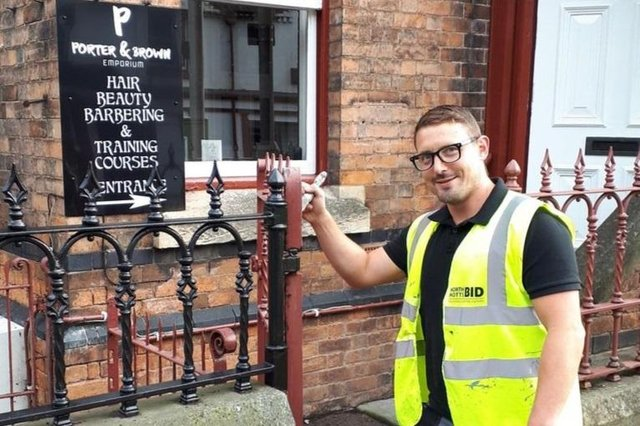 Andy Tomlinson, of BID,supporting Porter and Brown Emporium with external maintenance.
