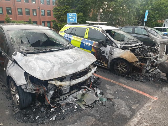 The burnt out police cars in Worksop.