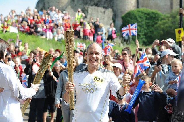 Olympic Torch bearer Tony Eaton arrives in Castle Hill, Conisbrough .