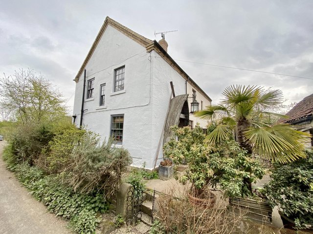 The characterful home benefits from views over open countryside.