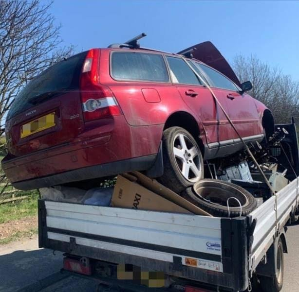 A car precariously balanced on the back of a scrap van was found by police during Operation Brigantia.