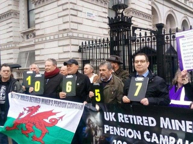 Former mineworkers campaigning outside Downing Street for a farer pensions deal