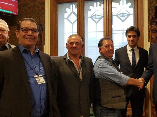 Former mineworkers and campaigners in Parliament in 2019, with ex-Labour leader Ed Miliband.