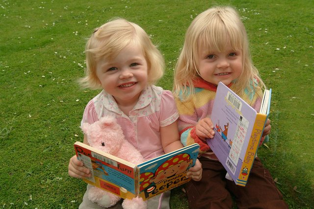 Picnic and storytelling for children in the memorial gardens - in conjunction with library services and Surestart in 2007 Picture: L-R: Sophie Spencer, (2) & Molly Hind, (3)