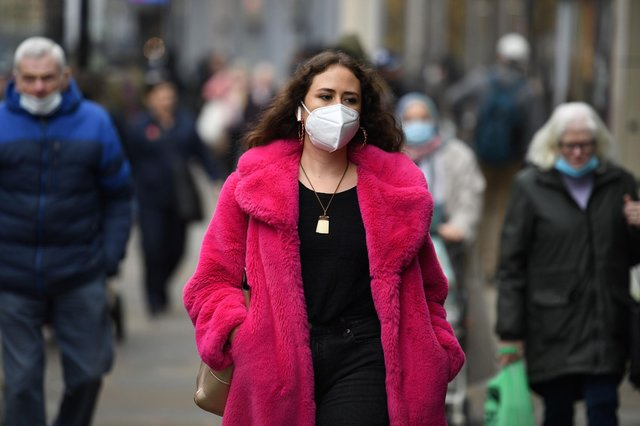 A shopper wears a face-mask (Photo by Oli SCARFF / AFP) (Photo by OLI SCARFF/AFP via Getty Images)